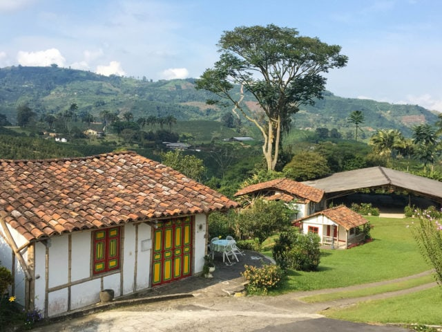 Farm buildings with tile roofs and colorful trim