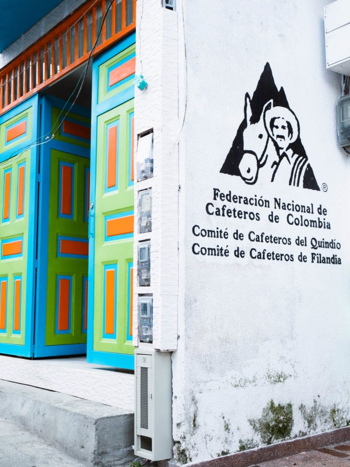 Colorful doorway and sign for the Colombian coffee federation
