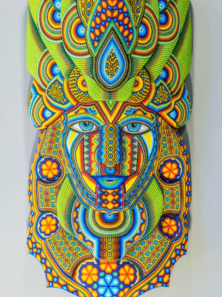 Bright blue, green, yellow, and red beaded mask