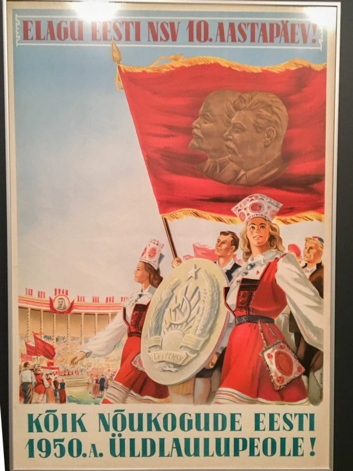 Soviet propaganda poster showing blond women in red and white carrying a flag