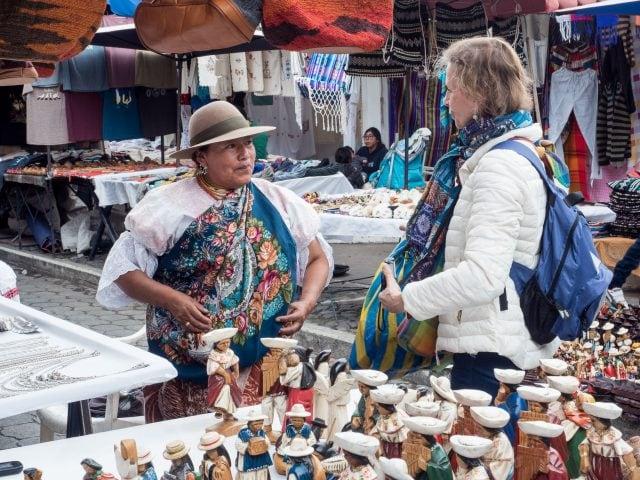 Tourist shopping at Otavalo market