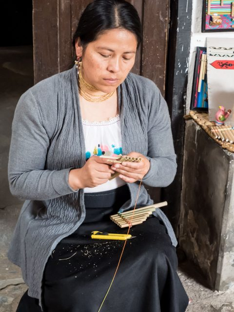 Woman making panflute