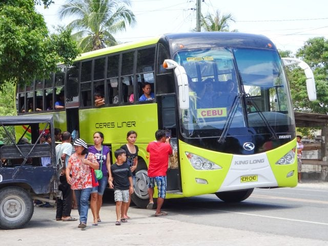 Bus from Cebu lets out passengers in Moalboal