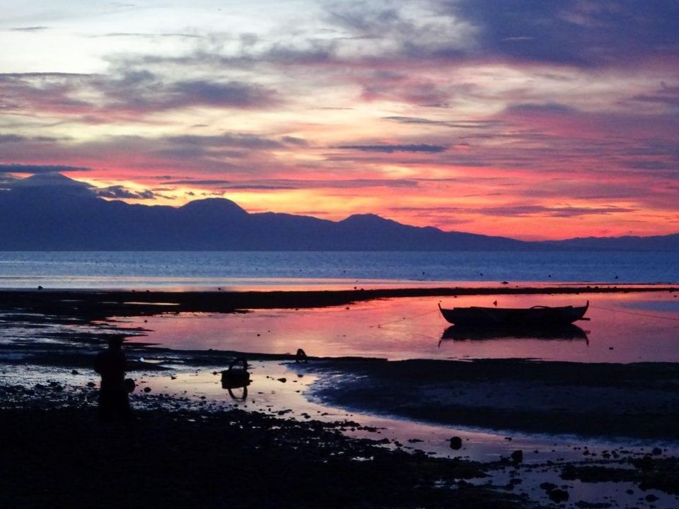 Orange, pink, blue sunset over shore on Siquijor