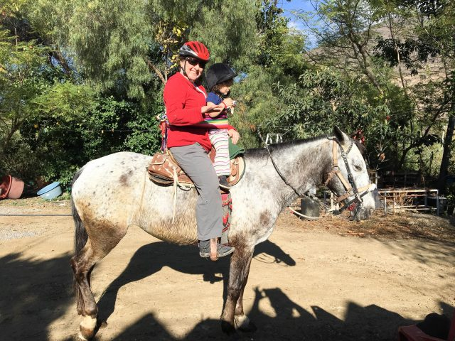 Chris and Francesca on a gray horse