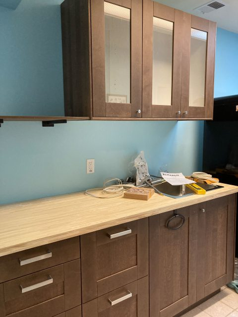 Brown kitchen cabinets and counter