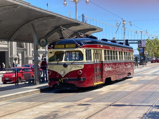 Restored 1940s red streetcar at stop near Ferry Building
