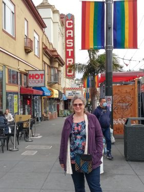 Melissa in front of pride flags and Castro Theater