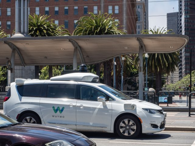 White Waymo self-driving taxi