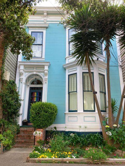 Aqua-colored house and front garden