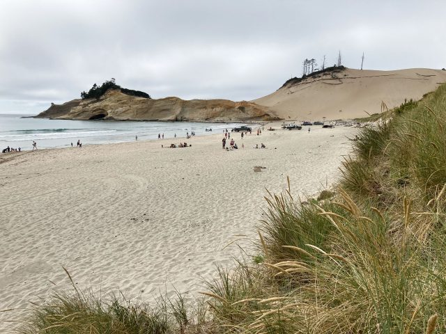 Sandy beach with high dune at the end