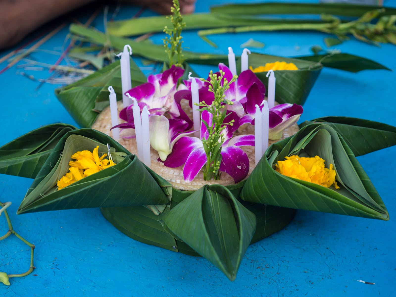 Offering made of leaves, flowers, and candles