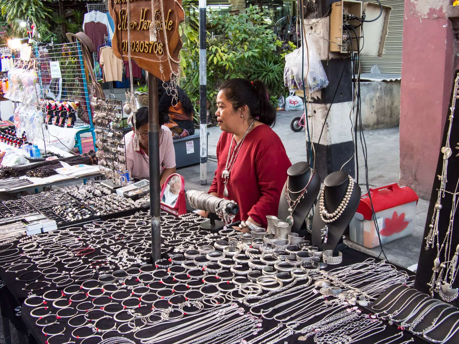 Woman selling silver jewelry at night market