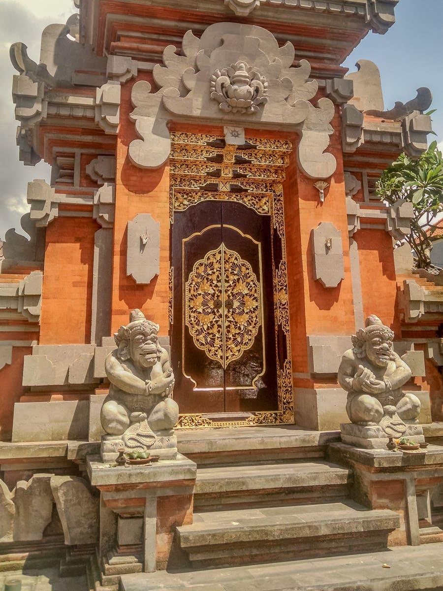 Orange and beige stone doorway in Denpasar